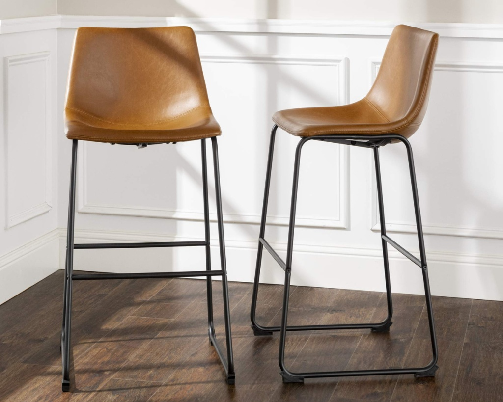 two brown faux leather stools