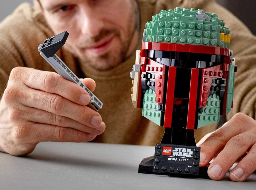 man building lego boba fett