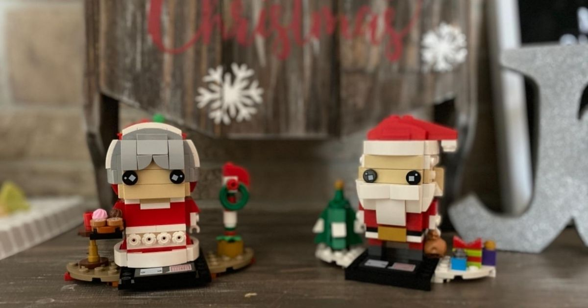 Mrs Claus and Santa LEGO brickheadz with holiday decor in background