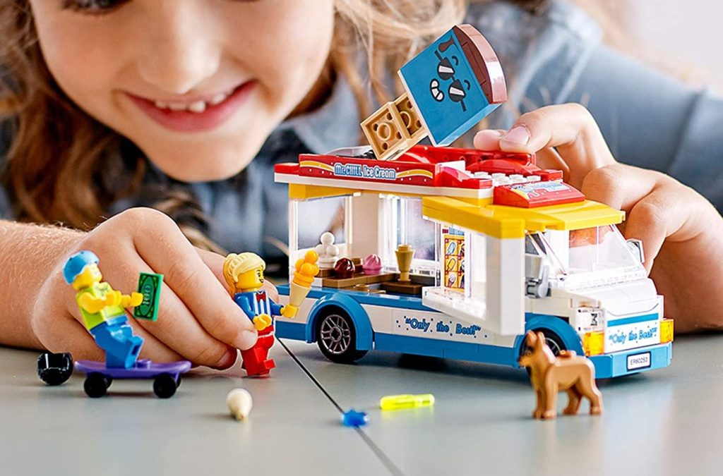 girl playing with lego city ice cream truck