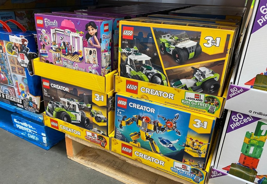boxes of legos in store stacked on floor