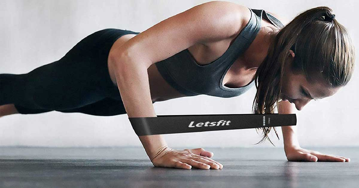 woman doing plank with resistance band