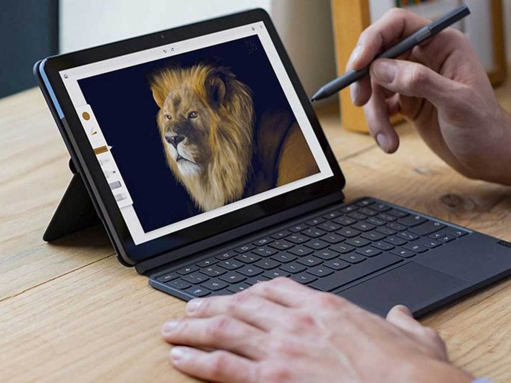 """hands holding stylus on a Lenovo Chromebook Duet 10.1"""" ChromeOS 2-in-1 Tablet w/ Detachable Keyboard"""