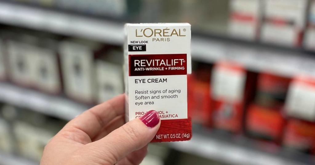 woman holding loreal revitalift eye cream