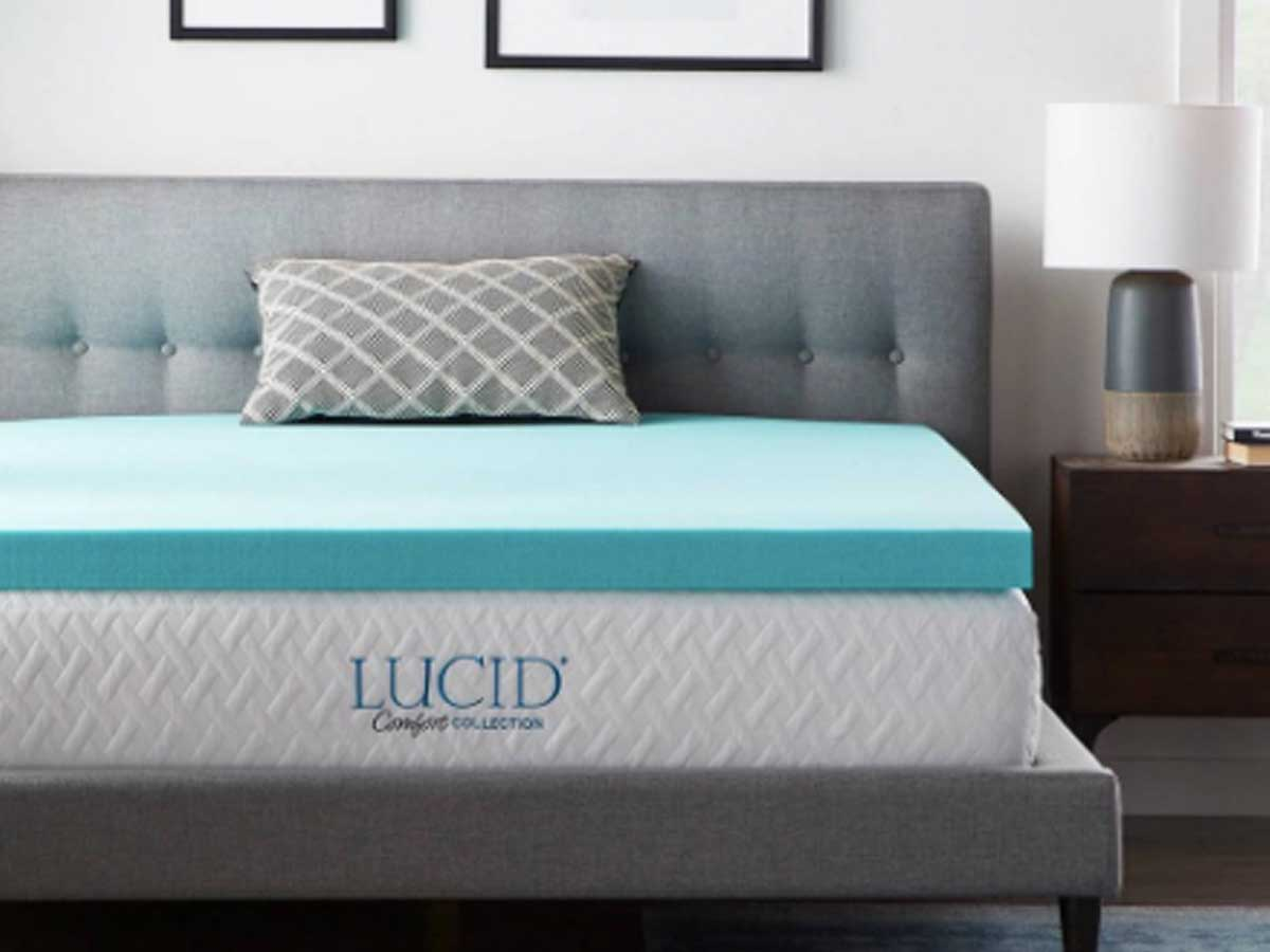 bed with a mattress topper