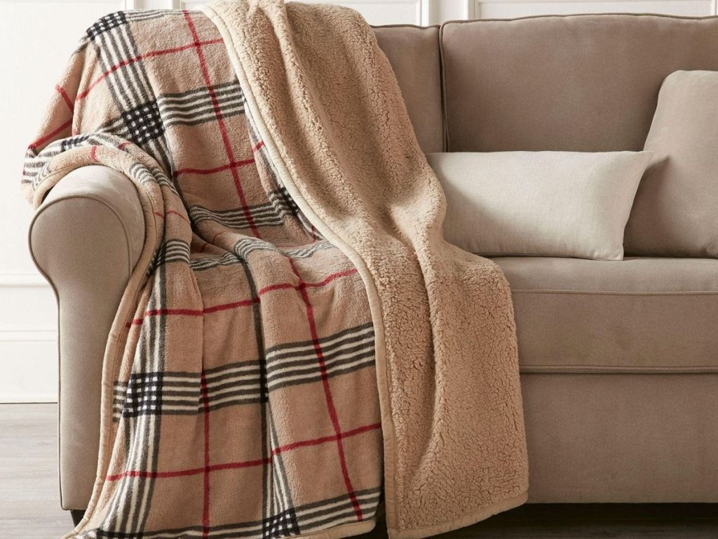 plaid throw on tan couch