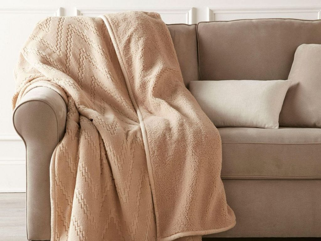 cream colored throw on tan couch