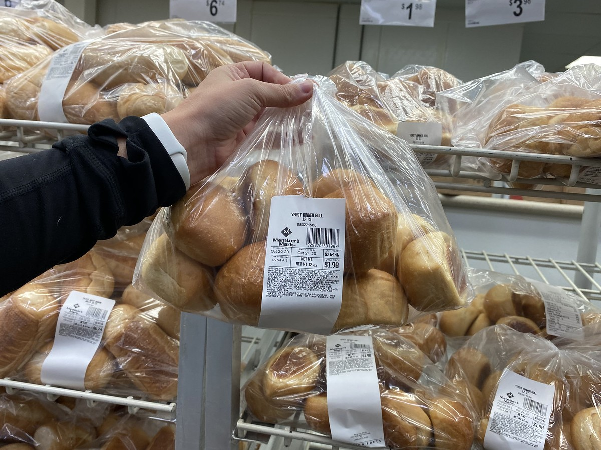 holding bag of Yeast Rolls at Sam's Club