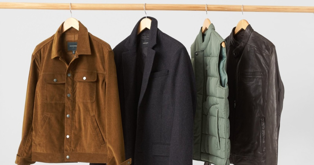 mens clothes on a rack jackets and vests