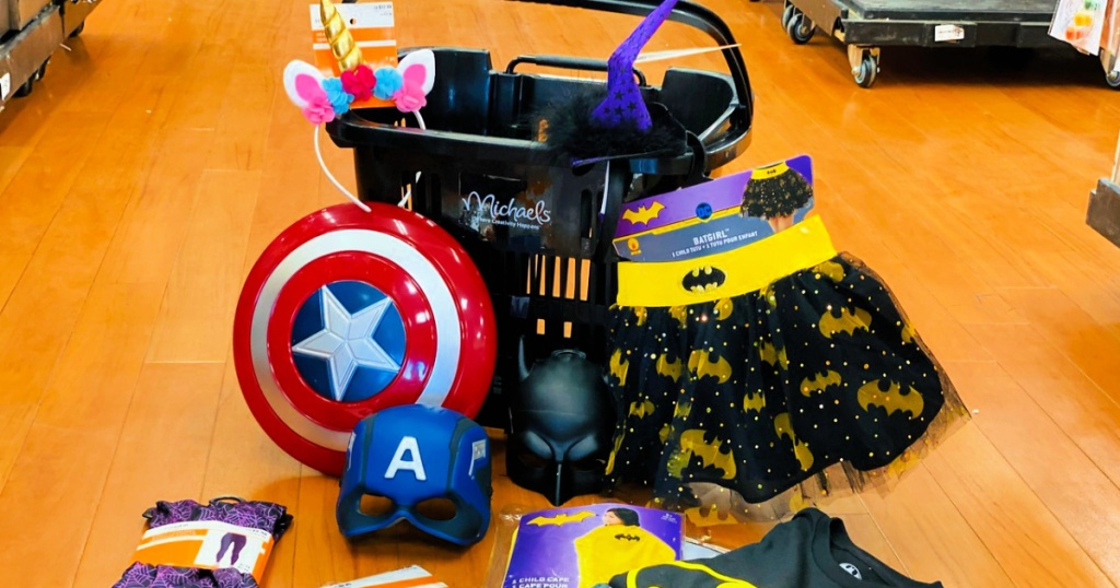 michaels halloween items on floor with michaels shopping basket