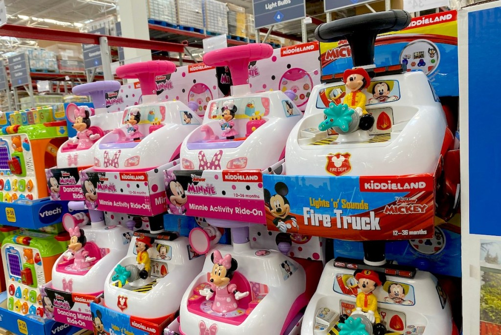 minnie mouse ride on toy stacked in store