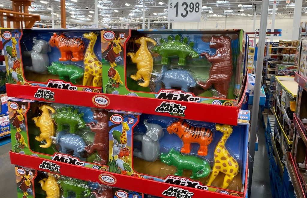 stack of dinosaur toys in store aisle