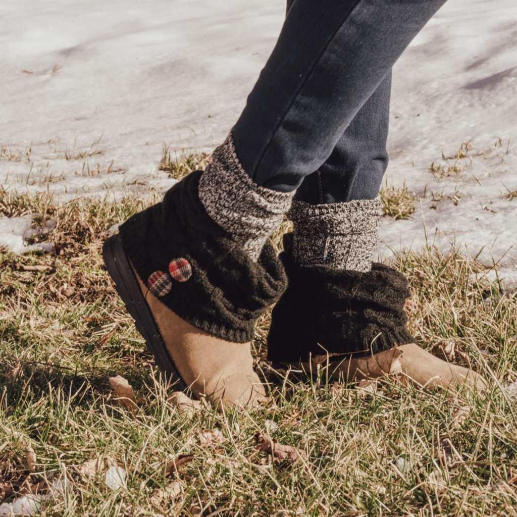 muk luks patti boots on feet in grass