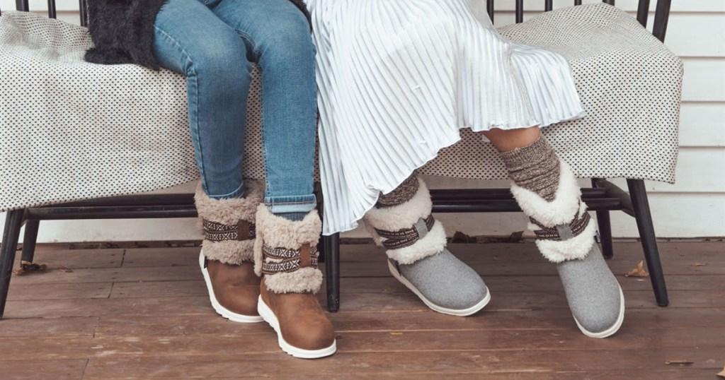 muk luks tamara boots two pair on two women sitting on bench