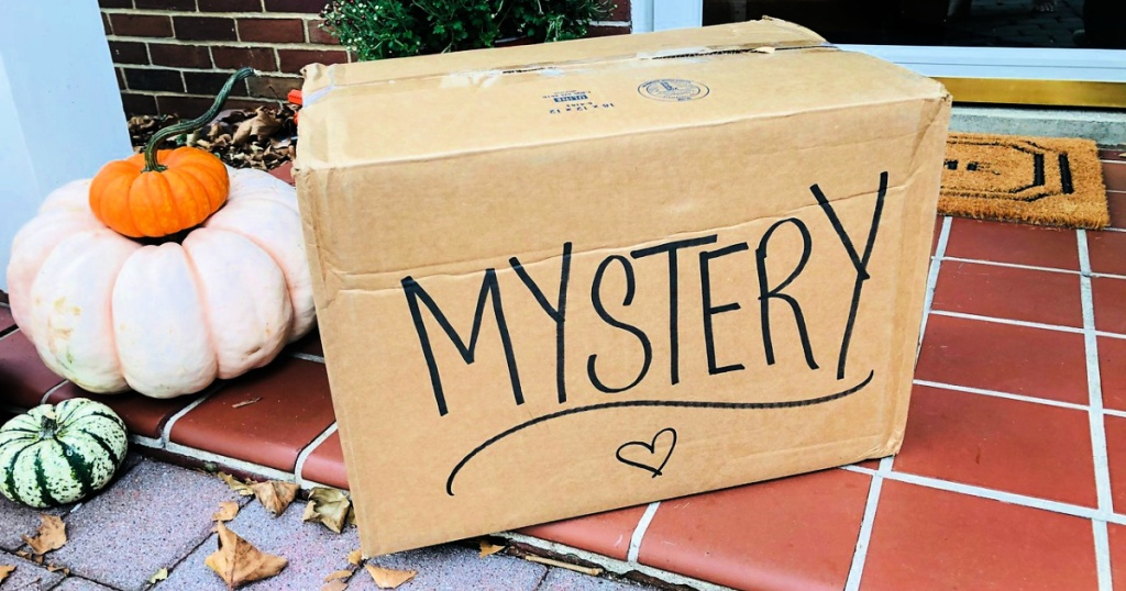 mystery box on front doorstep with fall decor