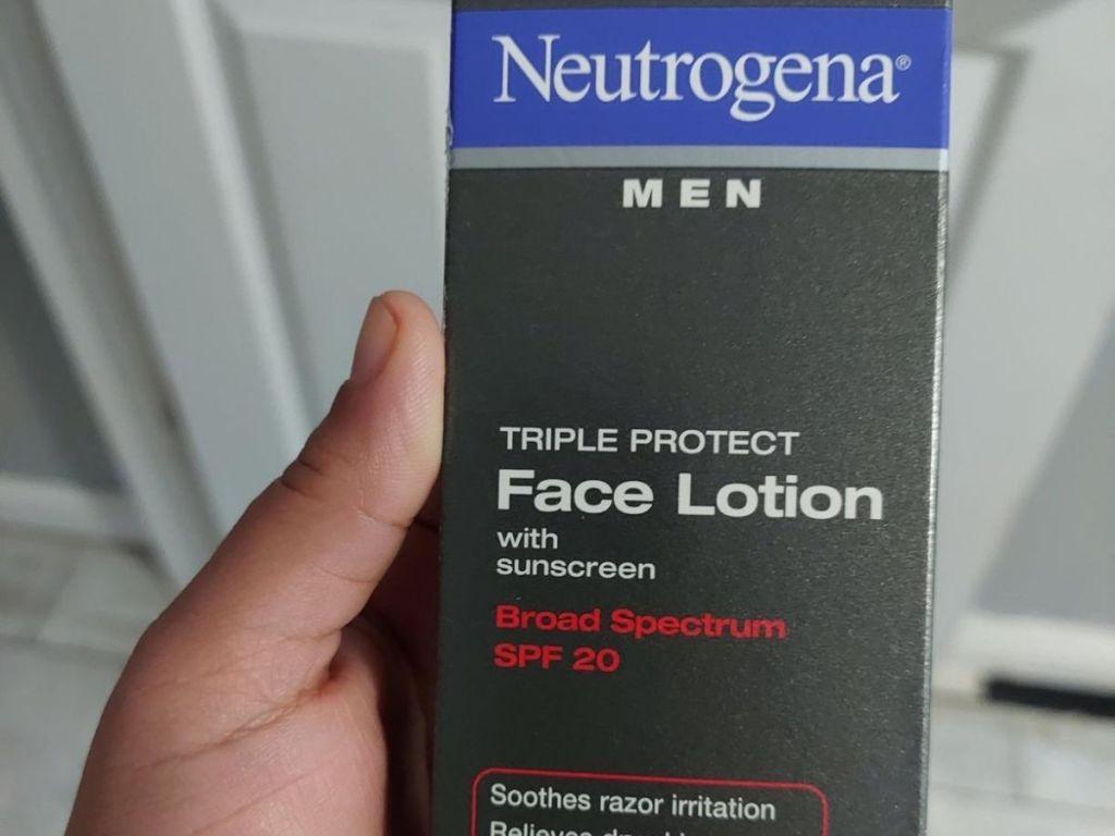 hand holding bottle of neutrogena lotion
