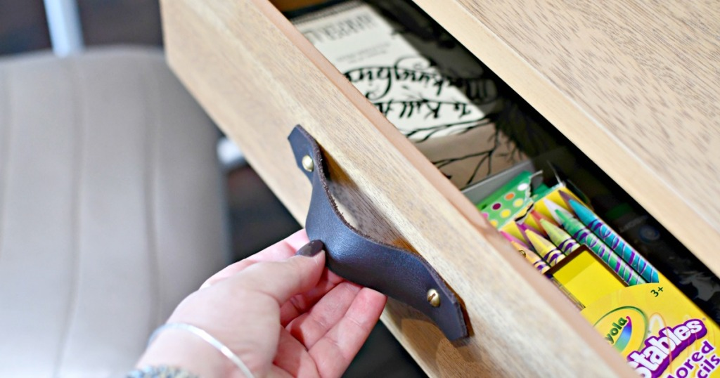 opening a drawer with leather drawer handles