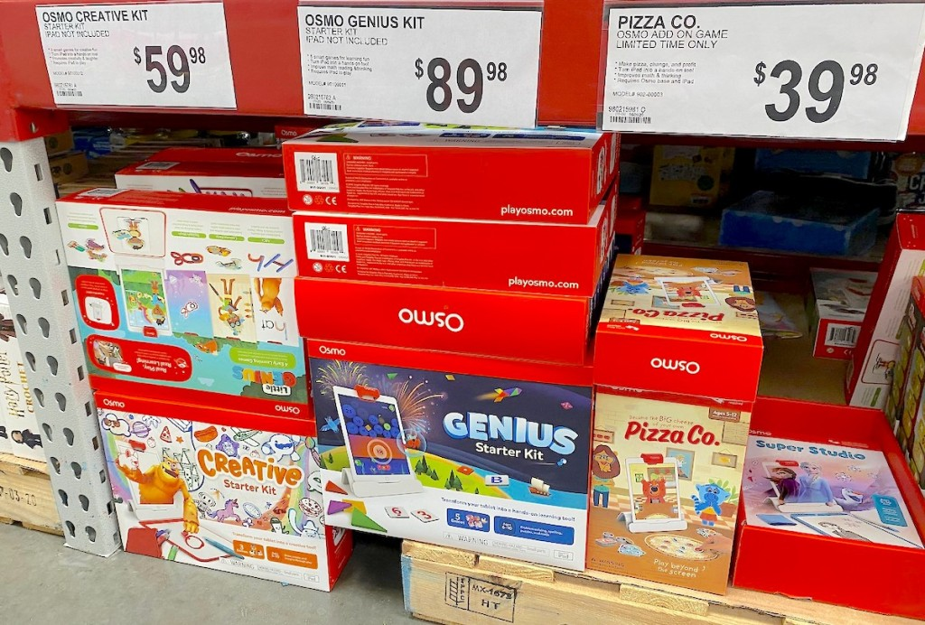 red boxes of osmo creative kids toys sitting in stacks on pallets on floor