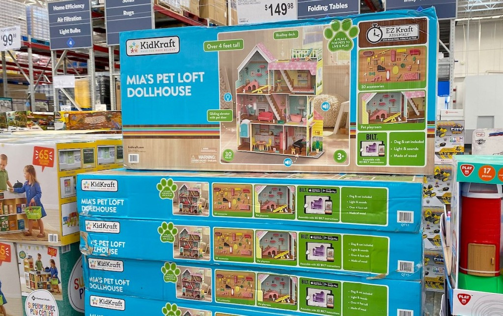 KidKraft Mia's Mansion Pet Loft Dollhouse in boxes stacked at store