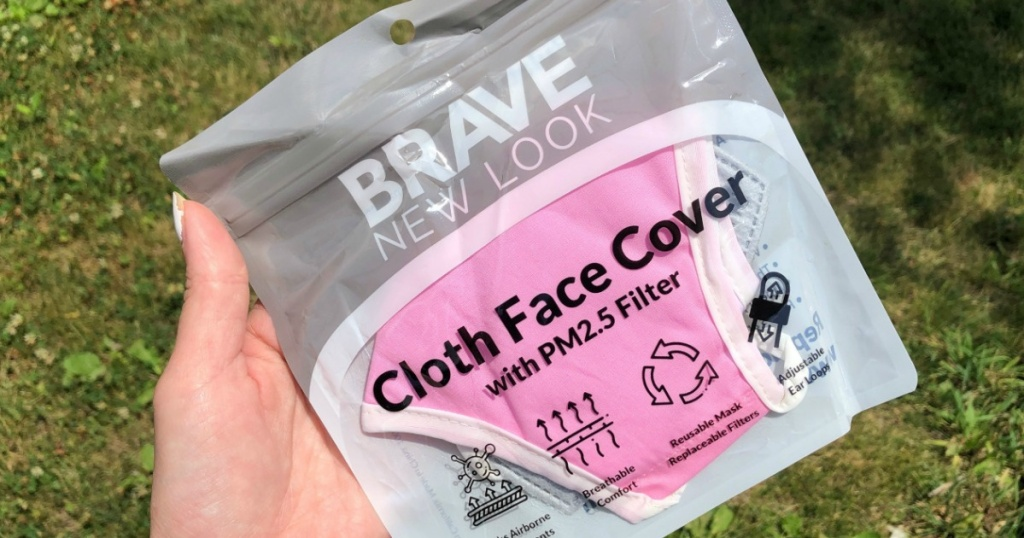 pink face mask in hand in wrapper
