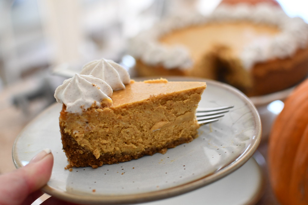 Pumpkin spice cheesecake slice on plate