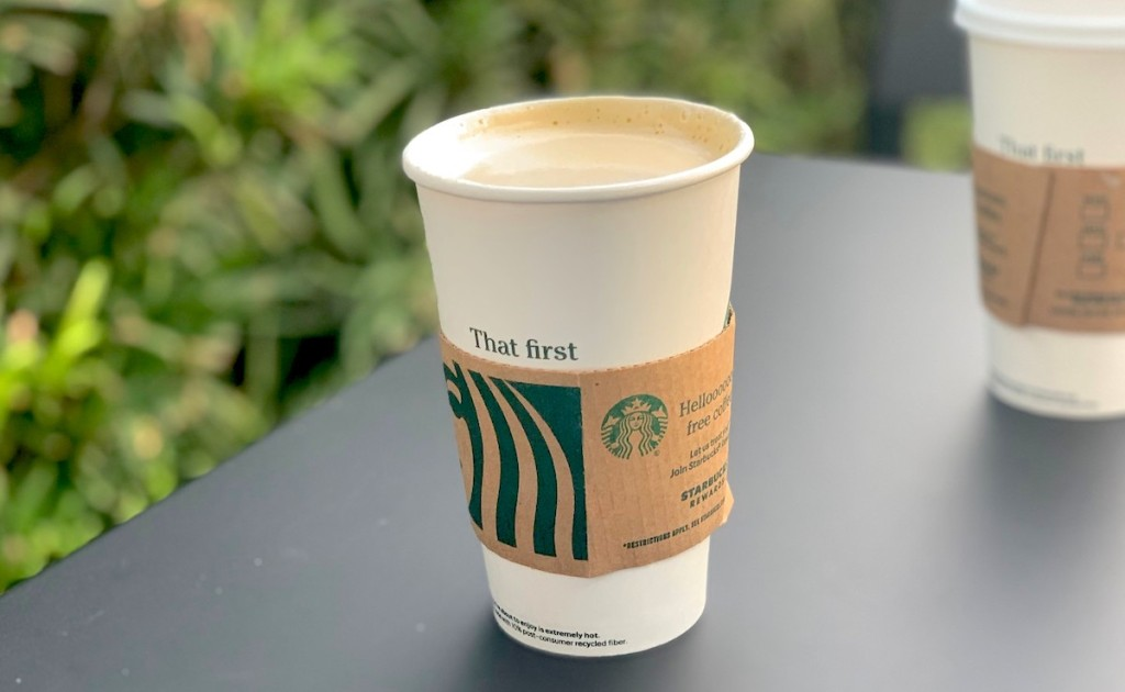 pumpkin chai drink sitting in starbucks cup on table outside