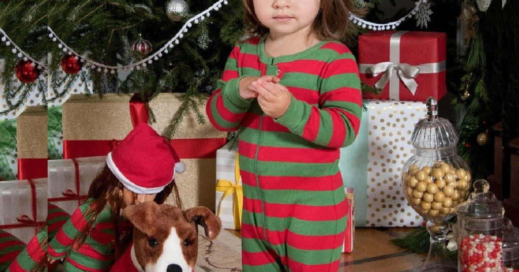 red and green striped footie on little girl near tree