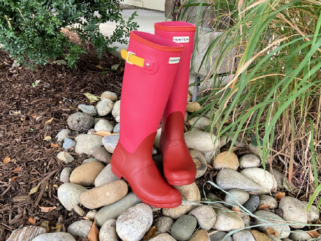red hunter boots outside on rocks