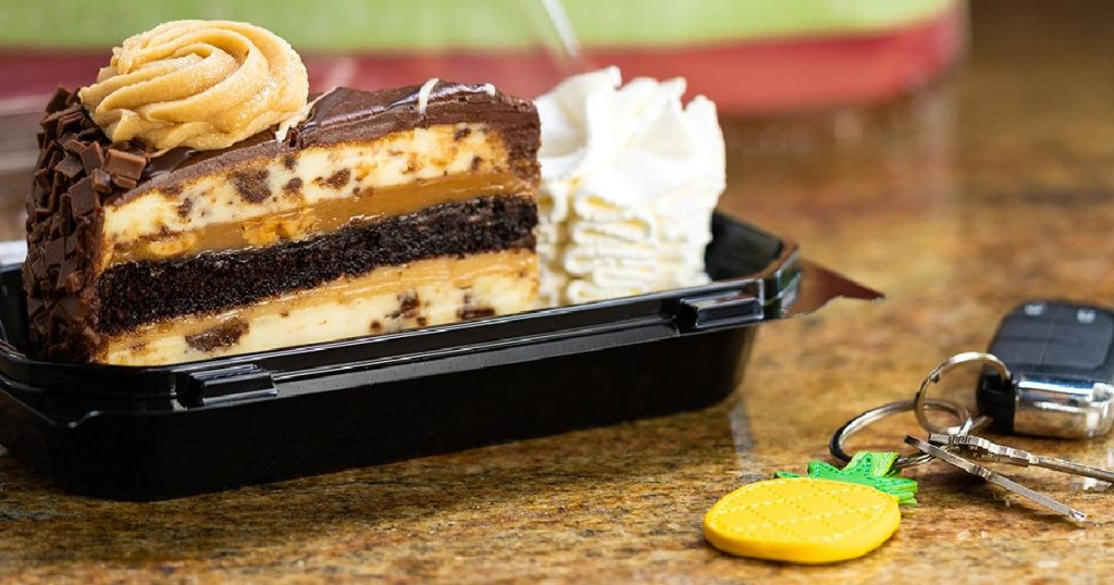 reese's cheesecake in togo box next to keys