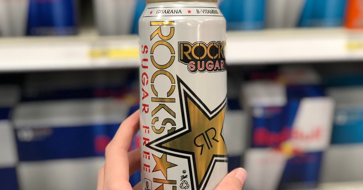 rockstar energy drink in store in hand