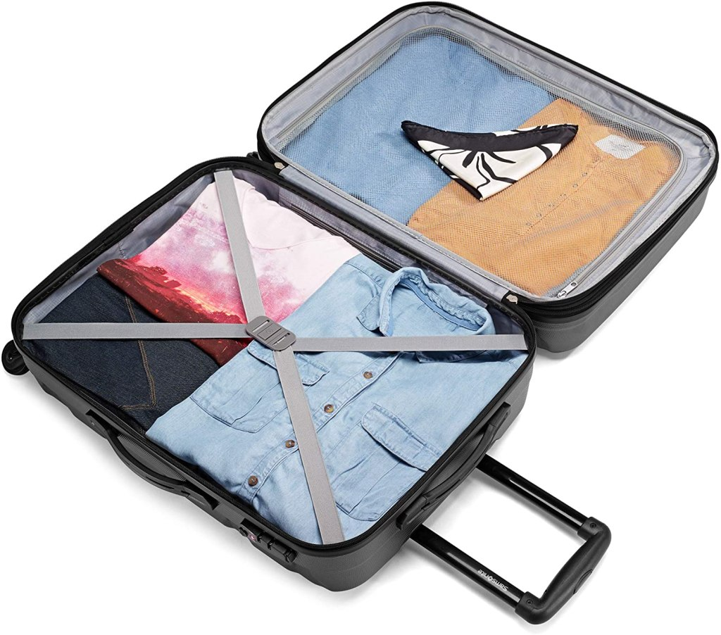 samsonite omni luggage open with clothes inside