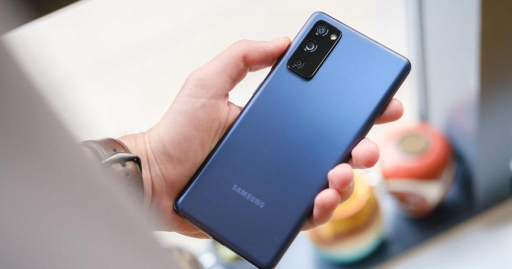 samsung galaxy phone in hand facing backwards