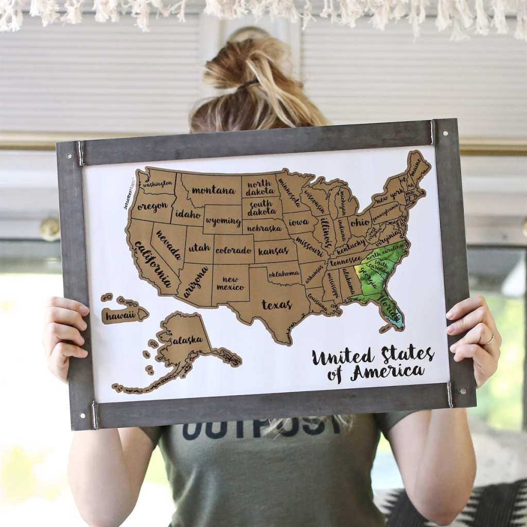 scratch off map covering girls face