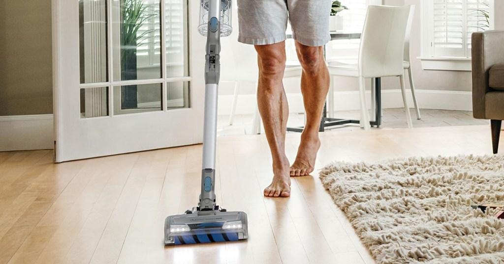 shark vacuum in living room with guy vacuuming