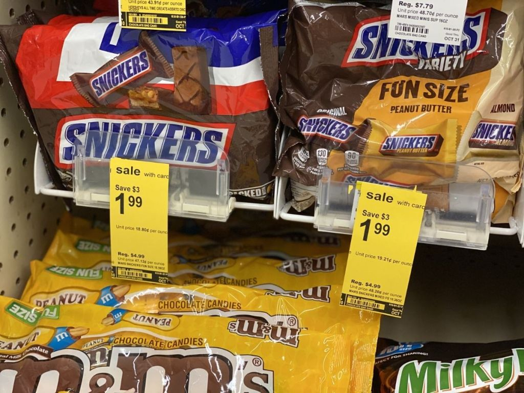 Snickers fun size candy bags with sale tags on shelf