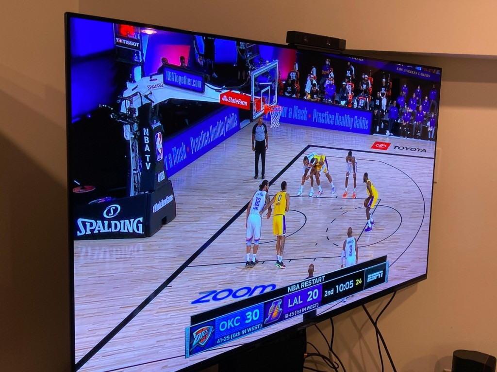 "55"" TV showing basketball game"