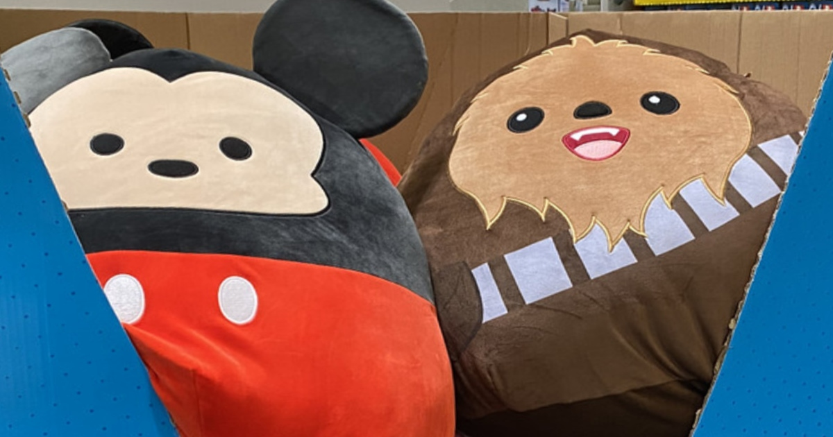 Two squishmallows in a blue box bin in store. One is a Disney Mikey and the other is a Star Wars Chewbacca