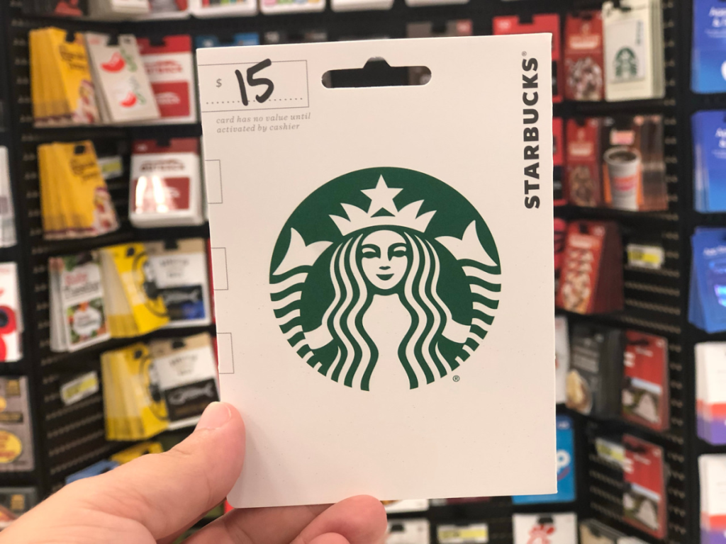 hand holding up gift card near store display