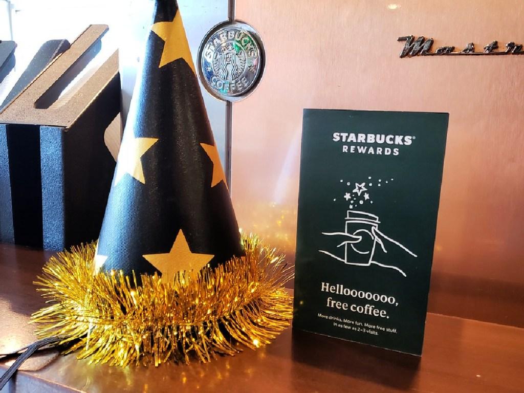 starbucks rewards informational flyer and birthday hat