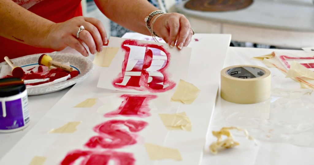 stenciling a porch sign for christmas