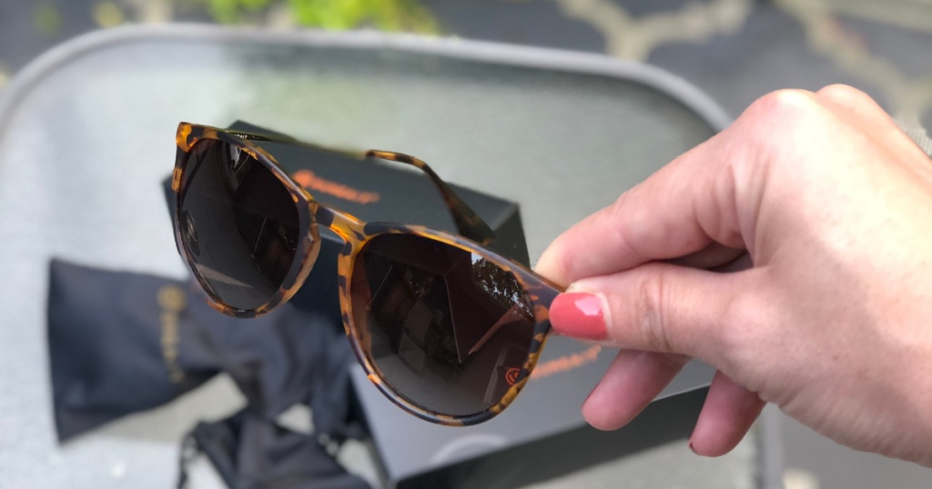 sungait sunglasses in hand