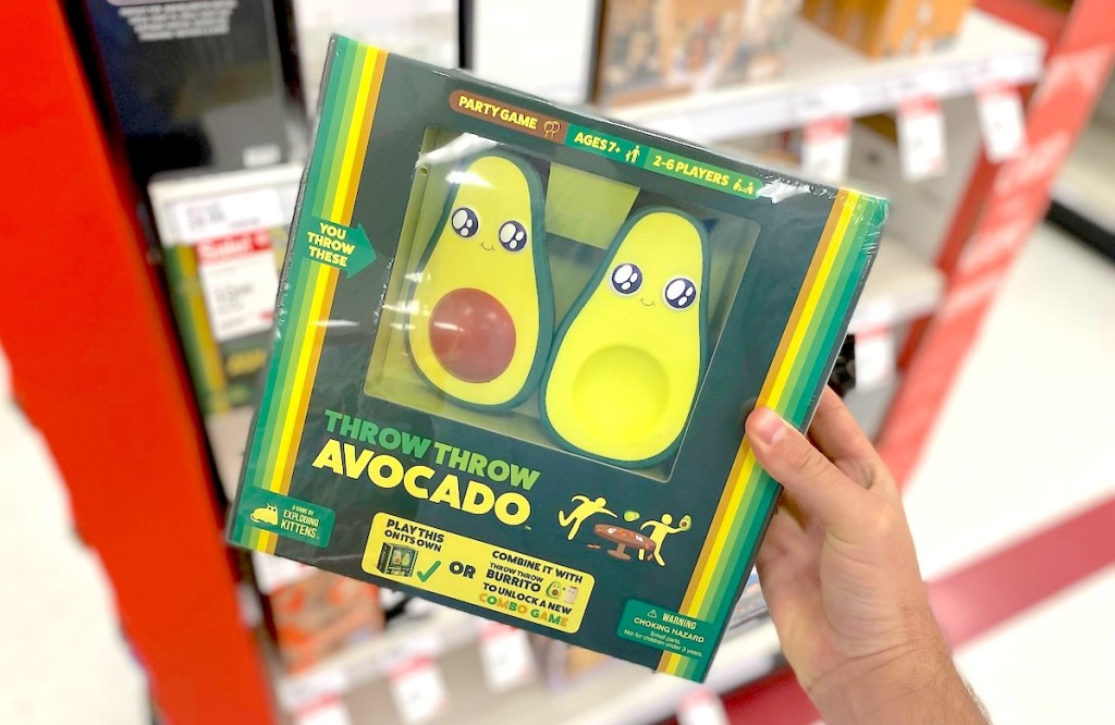 hand holding throw throw avocado game in hand