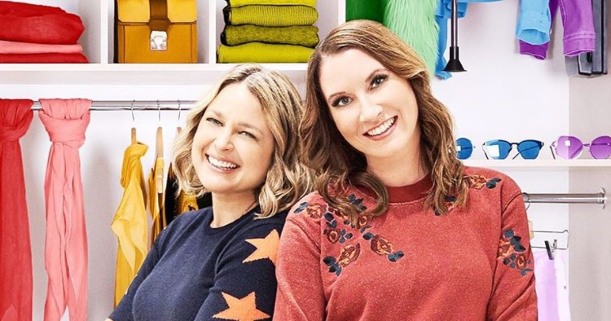 stars of The Home Edit in front of a wall of colorful, organized items