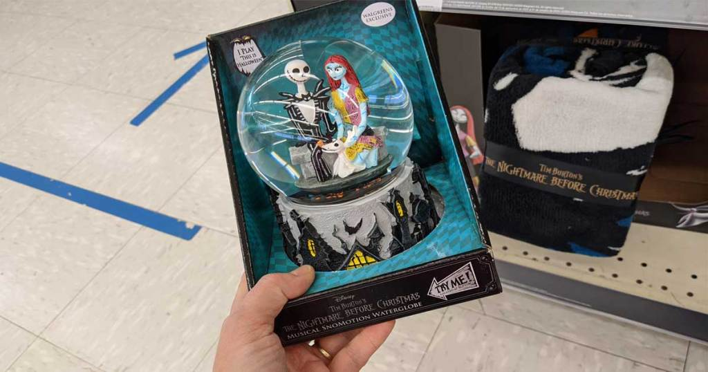 Hand holding a Disney Nightmare Before Christmas near in-store display
