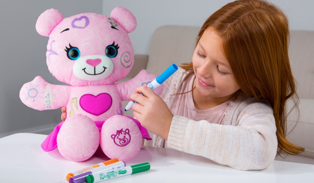 the original pink doodle bear with little girl coloring