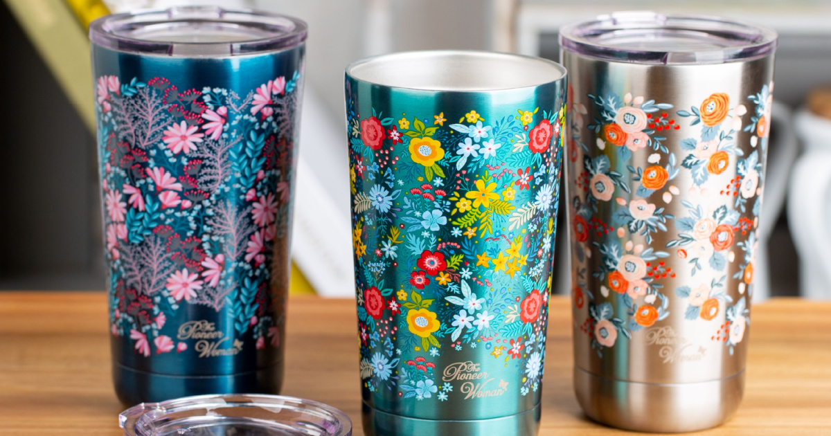 three colorful tumblers on table