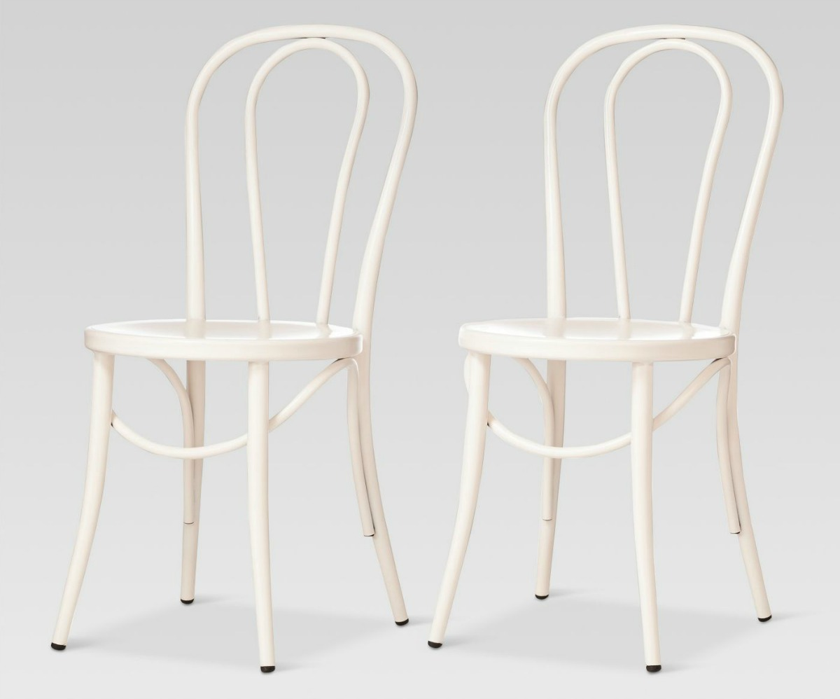 two white metal bistro chairs