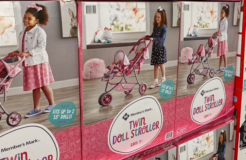 boxes of twin doll strollers at store
