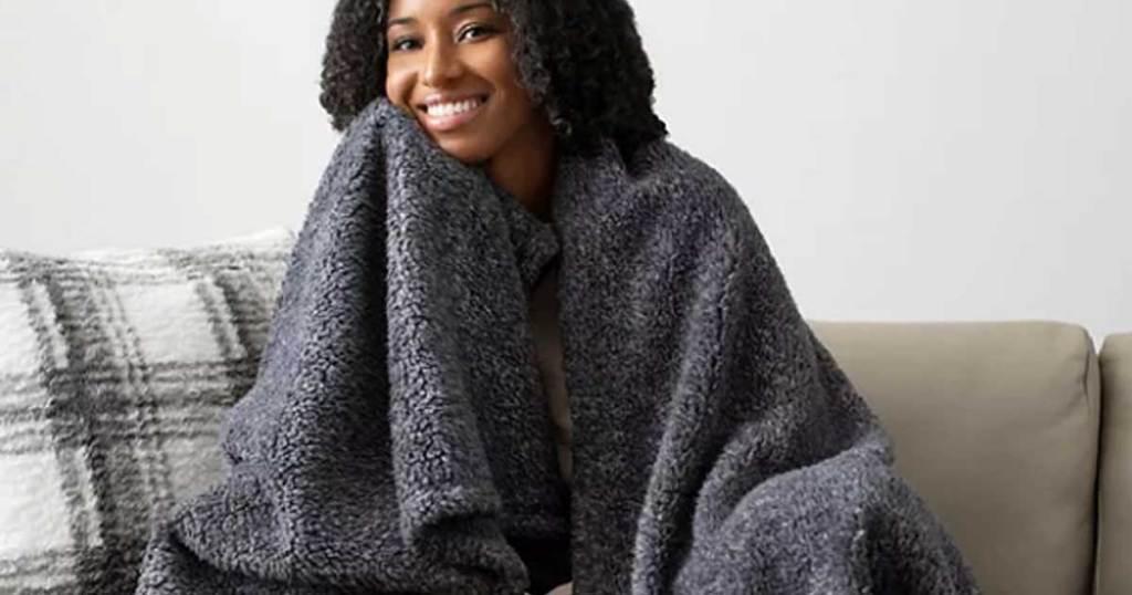 woman wrapped in throw blanket