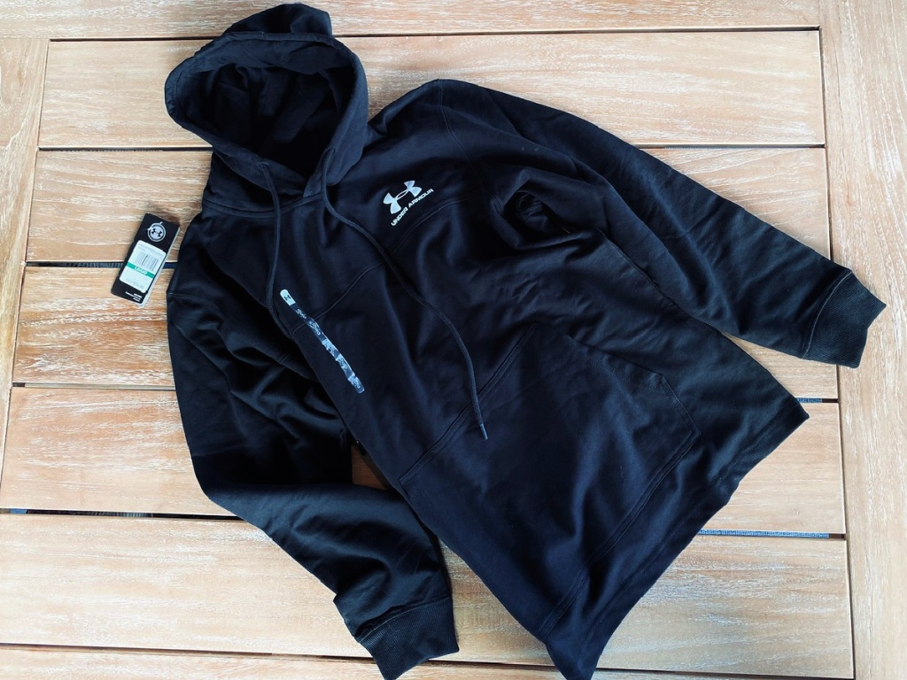 under armour men's pullover on wooden table
